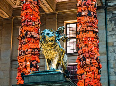 Detail of the installation of Ai Weiwei. The columns of the Konzerthaus Berlin full of lifejackets. 2016