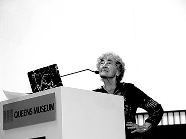 Lucy Lippard lecturing at the Queens Museum. Source: The Artist Information Company