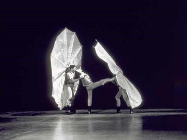 Film still from Pelican (1963) Choreography by Robert Rauschenberg, interpreted by Carolyn Brown, Per Olof Ultvedt and Rauschenberg. Courtesy Robert Rauschenberg Foundation Archives